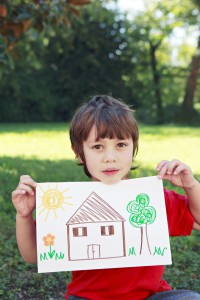 kid with house drawing